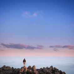 Tag someone you'd love to stand in a spot like this with!  @lovethywalrus recently witnessed a stunningly majestic sunset from kunanyi / Mt Wellington where the clouds became the sea and the summit a rocky island bathed in gorgeous light. Thanks for tagging #travelstoke! by matadornetwork