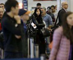 AP Photo/Seth Wenig Thanksgiving travelers battle rain and snow