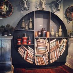 Cool bookshelf. Also like those round wall art things with little wood pieces. Sort of Asian flair.