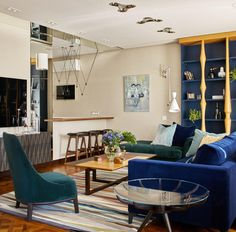 Contemporary, nature-inspired apartment clad in shades of brown and blue