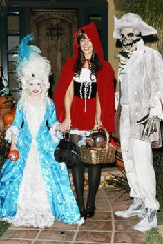 Kate Beckinsale goes trick-or-treating in Santa Monica dressed as Little Red Riding Hood with a skeletal husband, Len Wiseman, and daughter Lily, as a young Marie Antoinette.