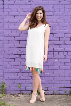 The perfect white summer dress with colorful tassels. Such a fun girls night out dress! Paired with strappy nude heels.