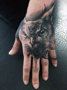 owl hand tatoo