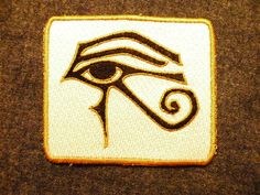The Eye of Ra (Horus) is an ancient Egyptian symbol of protection, royal power and good health. The fully embroidered patch is 4.06 wide and 3.61 high. It is embroidered with black and gold on a cream background with a gold colored edge.    This patch is fully iron on with no sewing required, although it is advised that patch be sewn on frequently laundered items.    Use to personalize your jacket, backpack, messenger bag, or just about anything you can imagine.    Please note these colors…