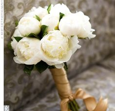 White peony with gold wrapping if bridesmaids dresses are green. Simple and elegant.