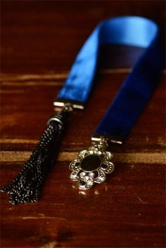 Recycle jewelry into pretty velvet bookmarks