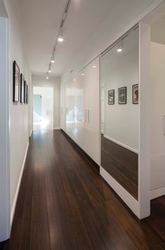 Lighting fixtures home design white walls for modern hall decoration ideas with hallway storage and high gloss closet doors also framed art plus dark Design, House Design, Modern Hall, Hall Decor, Hallway Storage, Shingle Style Homes, White Walls, Modern Renovation, Dark Brown Wood Floors