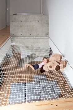 The large net above the living room in this home makes for a fun play area for the kids and a relaxing spot to lounge.