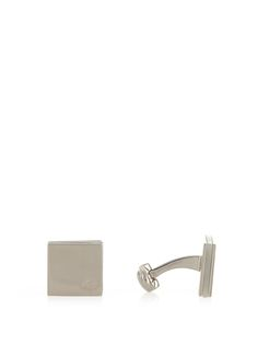 Add a note of refinement to formal looks with Mulberry's silver-plated brass square cufflinks. They're engraved with the label's signature tree logo and inlaid with a mother-of-pearl centre. Fasten them at the swivel backs.