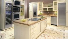 The Caesarstone countertops in Carmel 9350 are stylish and durable and match perfectly with the modern appliances and colorful flooring.