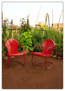 The Red Chairs. Old style metal chairs at the Sunflower Festival in Rutledge, Georgia. See us there June 30 and July 1.