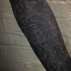 15 Striking Blackout Tattoos That Almost Look Unreal