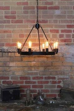 This bold black Chandelier infuses rustic style design with a touch of industrial flair. The Large circular black metal ring and Eight bulbs provides character. Black Chandelier, Rustic Chandelier, Rustic Lighting, Home Lighting, Lighting Ideas, Chandeliers, Ceiling Pendant, Ceiling Lights, Ceiling Rose