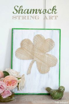 String art projects are inexpensive to make but pack impressive results! Create your own shamrock art decor with just some string, nails and a wood plaque.