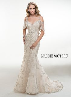 Maurine Description Illusion cold shoulder flutter sleeves adorn this dazzling Swarovski crystal embroidered tulle A-line gown finished with crystal buttons and zipper over inner elastic back closure. Includes detachable grosgrain ribbon belt with Swarovski crystal embellishment