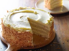 Throwdown's Toasted Coconut Cake with Coconut Filling and Coconut Buttercream recipe from Bobby Flay via Food Network