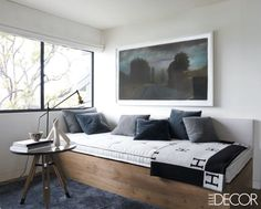 In the master bedroom's sitting area, a painting by Matt Palmer hangs above a custom-made daybed; the throw is by Hermès, and the rug is by the Rug Company.