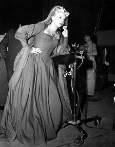 Lana Turner takes a phone call on the set of The Three Musketeers