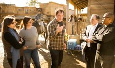 Producers Stacey Sher, Pilar Savone, director Quentin Tarantino, executive producers Bob Weinstein and producer Reginald Hudlin on the set of Django Unchained (2012).