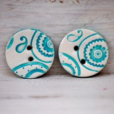 ceramic paisley flower buttons  by Cariad Clay - these would be cute earings