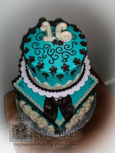 Sweet sixteen cake. Covered with buttercream. Accents with fondant.