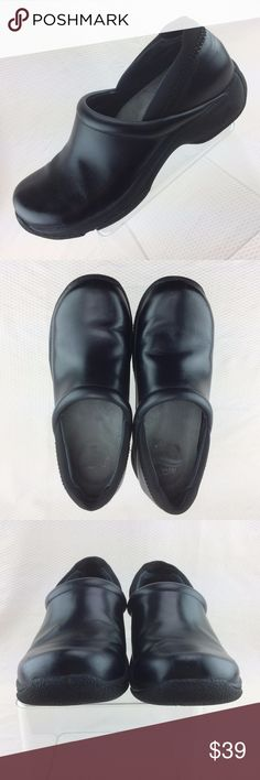 Dansko Black Work Clogs Slip Resistant EU 37 This listing is for one pair of Dansko Women's Clogs. Black Leather Upper. Approximately 1 inch heel. EU Size 37 translates to US 6.5 to 7 on Dansko size translation chart. Slip resistant rubber sole. Great pre-owned condition with some wear on sole and minor scuffs on leather.  Please examine pictures carefully for any damage or wear. Acrylic box and ruler in pictures not included.  Feel free to message me with any questions. Thank you for your…