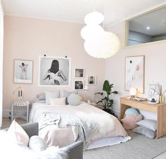 Pastel pink and grey Scandinavian Nordic bedroom with asymmetrical art gallery wall.  Norsu interiors.