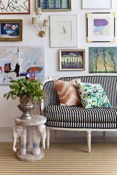 (love the eclectic bunching of framed art) Little Green Notebook: Easy Envelope Pillows