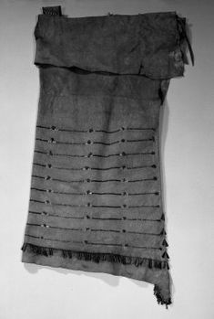 Yankton, Nakota, Sioux (Native American). Sidefold Dress, early 19th century. Buffalo hide (?) dyed bird and porcupine quills, copper, tinned iron and copper cones, pony glass beads, yarn, pigment, sinew, thong, 50 x 16 in. (127 x 40.6 cm). Brooklyn Museum, Henry L. Batterman Fund and Frank Sherman Benson Fund, 50.67.6. Creative Commons-BY (Photo: Brooklyn Museum, 50.67.6_acetate_bw.jpg)