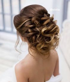 Featured Hairstyle: Elstile; Messy wavy updo wedding hairstyle idea.