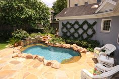 Backyard with flagstone deck and professionally installed cocktail pool.