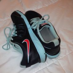 03461e7e7d Shop Women s Nike size Sneakers at a discounted price at Poshmark.  Description  Lightly used black and blue shoes with a pop of orange-ish red.