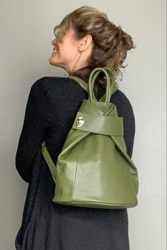 A unique turn lock strap - carry as a backpack or if more room is needed secure strap behind to carry as a tote like this image. The wide bottom makes for a roomy bag - love to travel with. The outside back zip pocket fits a passport perfectly. Your items are secure with the zip top. This green is a great neutral - available in several colors. Thick Italian leather - Made in Italy. #womenbagsfashion #worktote #tote #travelessentials #leatherhandbags #pursesandbags #bagsandpurses #carryonbag Leather Backpack Purse, Work Tote, Free Travel, Travel Backpack, Italian Leather, Leather Handbags, Purses And Bags, Backpacks, Shoulder Bag