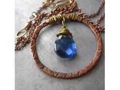 Hand Forged Copper Circle Pendant Necklace with Sapphire Blue Faceted Crystal $36