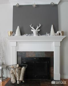 Painting the area above the mantel makes a nice modern touch and a great backdrop for displays. Source: My Sister's Suitcase.