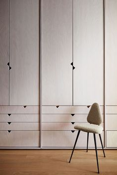 a wall of light-colored wood closets and a small chair Bedroom Closet Design, Bedroom Wardrobe, Wardrobe Design, Built In Wardrobe, Closet Designs, Wooden Wardrobe, Wardrobe Closet, Wall Of Light, Ny Loft
