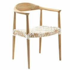 """Artfully crafted of reclaimed teak wood, this chic arm chair's intricately laced seat offers a touch of breezy appeal.     Product: Chair Construction Material: Reclaimed teak and rattan  Color: Light oak and white   Dimensions: 31"""" H x 25"""" W x 21.5"""" D"""