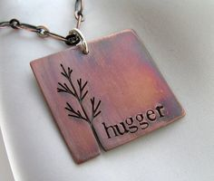 Tree Hugger stamped and sawn copper tree pendant - made to order. $28.00, via Etsy.