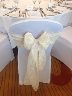 Ivory taffeta and Ivory lace sashes on white lycra stretch chair covers