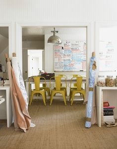 Bright yellow chairs around a long table and plenty of space to let the creative juices flow.