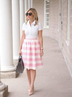 With a Midi Skirt Give your collared shirt a feminine twist as Suburban Faux-Pas did. Tuck it into a full midi skirt—the silhouette flatters everyone—and slip on pointed pumps for a daytime event or a fun brunch. Midi Skirt Outfit, Full Midi Skirt, Midi Skirts, Skirt Outfits, Polo Outfits For Women, Polo Shirt Women, Clothes For Women, Polo Shirt Outfit Women's, East Coast Fashion
