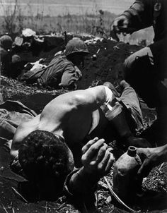 WORLD WAR II. The Pacific Campaign. 8 July 1944. Battle of Saipan Island. Wounded US Marines.