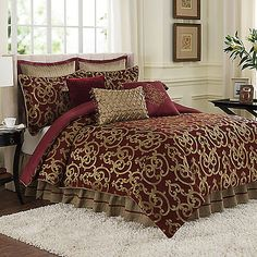 The Byzantine Comforter Set features a classic scroll design made of soft, luxurious velvet chenille in hues of antique gold and ruby and reverses to a solid faux-silk.