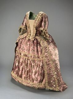 1760s Pink-purple satin brocade with a pattern of floral sprays worked in white and green.