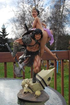 Conan carrying off a fair maiden.... just take away the axe... awesome fantasy football trophy topper