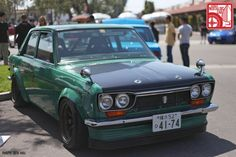 datsun 510 with a dobi-esque style air dam with rubber skirt.