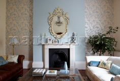 pale blue fireplace wall pics | Ornate mirror frame above fireplace with walls papered in Oriental ...