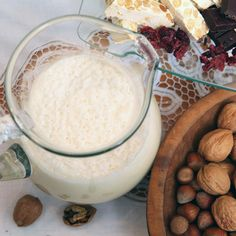 In Puerto Rico, as Christmas Eve approaches, groups of carolers playing the güiro (a percussion instrument made from a gourd), the cuatro (a four-stringed guitar), and maracas visit friends and neighbors, asking for food and drink. They are usually greeted with coquito, a frothy coconut drink spiked with rum. Here is my Puerto Rican cousin Elbita's recipe, with a couple of touches of my own.