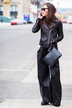 Jayne Min in a Dion Lee shirt + VEDA black leather jacket + Adam Lippes trousers + a black Mansur Gavriel clutch