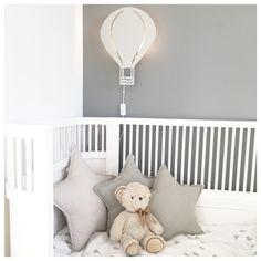 ferm LIVING Air balloon lamp: http://www.fermliving.com/webshop/shop/kids-room/kids-lamps/air-balloon-lamp-grey.aspx